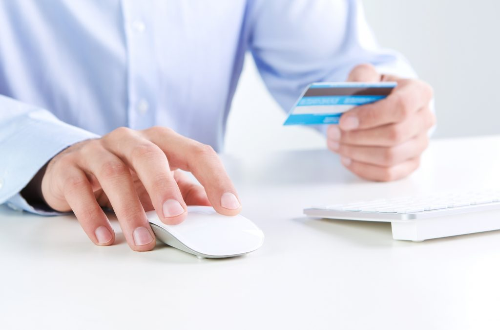 Online payment, close up of human hands shopping online