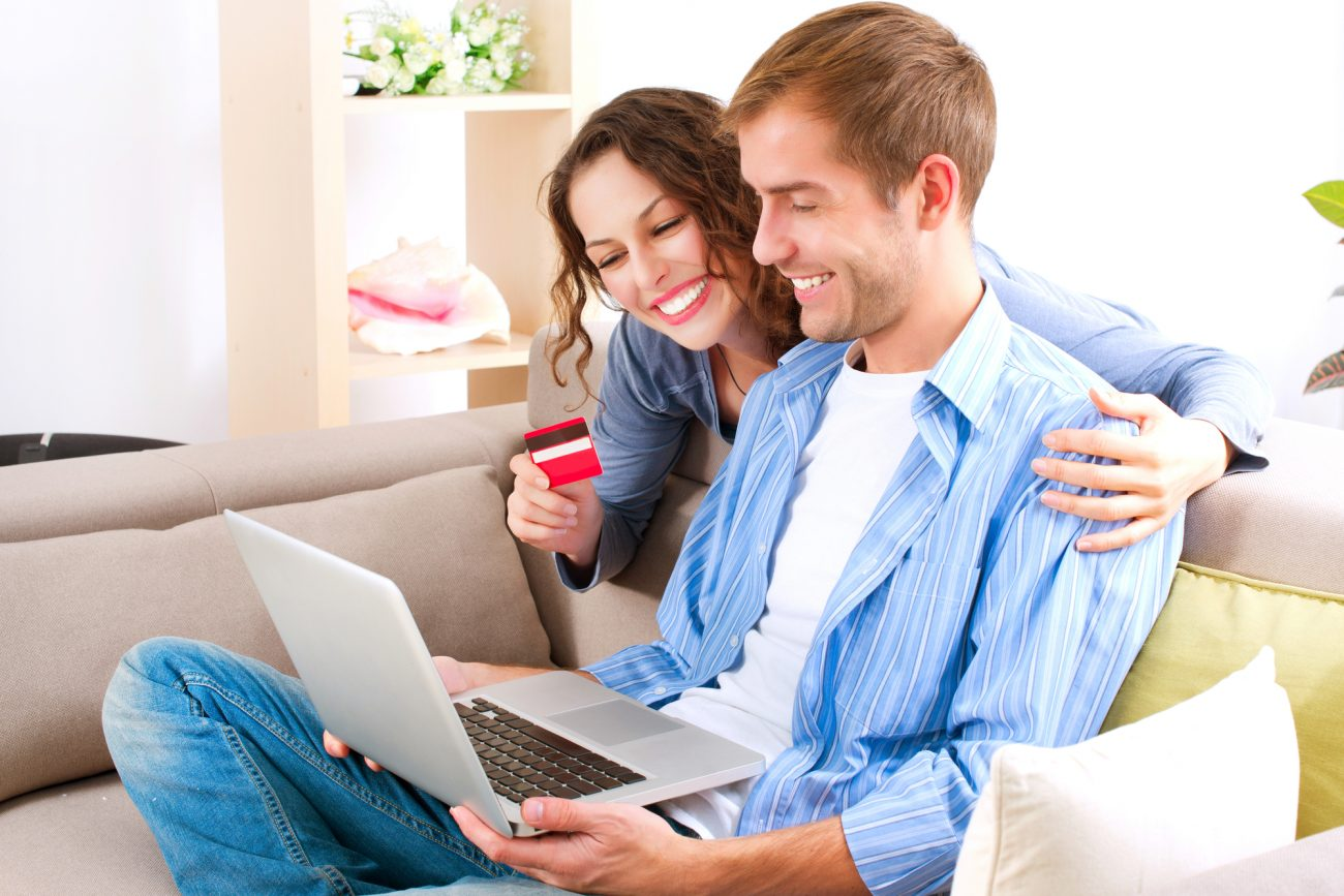 pencil-and-coffee-online-shopping-couple-using-credit-card-to-internet-shop