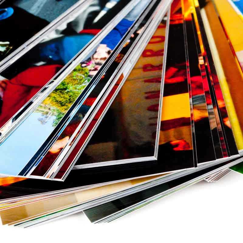 pencil-and-coffee-stack-of-the-photos-isolated-on-a-white-background